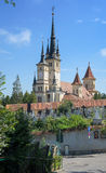 Saint Nicholas church in Brasov (Kronstadt), Transylvania (Siebenbuergen), Romania. Towers and grave yard, gate, sunny blue sky. Stock Photo