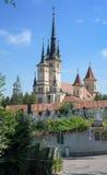 Saint Nicholas church in Brasov (Kronstadt), Transylvania (Siebenbuergen), Romania. Towers and grave yard, gate, sunny blue sky. Stock Photo