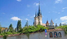Saint Nicholas church in Brasov (Kronstadt), Transylvania (Siebenbuergen), Romania. Towers and grave yard, gate, sunny blue sky. Royalty Free Stock Photography
