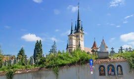 Saint Nicholas church in Brasov (Kronstadt), Transylvania (Siebenbuergen), Romania. Towers and grave yard, gate, sunny blue sky. Royalty Free Stock Photography