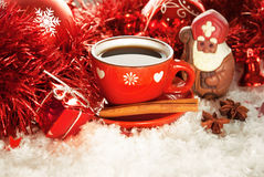 Saint Nicholas. Cup of coffee with chocolate Saint Nicholas and gift on a winter background Royalty Free Stock Image