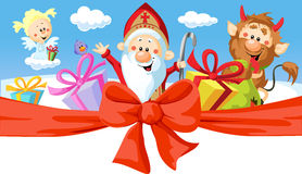 Saint Nicholas, devil and angel stock images