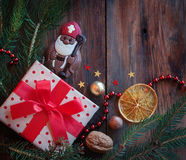 Saint Nicholas. And gift on a wooden background with winter decor Stock Photography