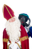Saint Nicholas and his helper Stock Photos
