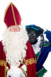 Saint Nicholas and his helper Stock Image