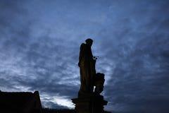 Saint Nicholas of Tolentino on the Charles Bridge in Prague. Stock Photos