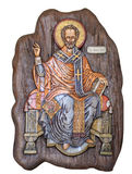 Saint Nicholas wooden icon. Wooden icon of Saint Nicholas isolated on white background royalty free stock photos