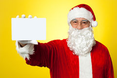 Saint Nick flashing a blank placard to the camera Stock Image