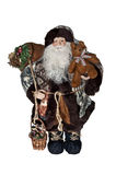 Saint Nicolas as Father Christmas. Santa Claus carrying bag and teddy bear. Dressed in natural outdoor clothes royalty free stock image