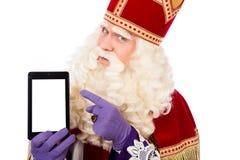 Saint-Nicolas avec le comprimé ou le téléphone intelligent photos libres de droits