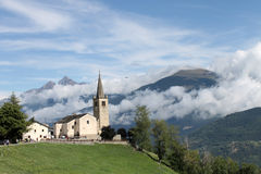 Saint Nicolas church. Saint Nicolas' church (ITALY) and view of high Aosta Valley Stock Photo