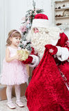 Saint Nicolas gives Christmas gifts Royalty Free Stock Image