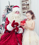 Saint Nicolas gives Christmas gifts Royalty Free Stock Photography