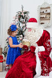 Saint Nicolas gives Christmas gifts Stock Images