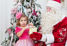 Saint Nicolas gives Christmas gifts Stock Photo