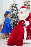 Saint Nicolas gives Christmas gifts Stock Photos
