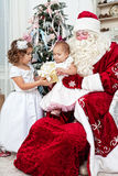 Saint Nicolas gives Christmas gifts Royalty Free Stock Images