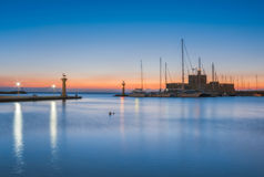 Saint Nikolaos fortress and the statue of the Deer at Rhodes island in Greece Stock Photography