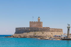 Saint Nikolas fort and medieval windmill in Mandraki port, Rhodes Royalty Free Stock Image