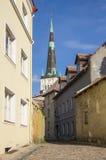 Saint Olaf church. And houses of old Tallinn, ESTONIA Stock Photos