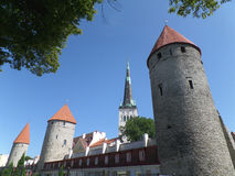 Saint Olaf's Church and City Wall Towers of Tallinn, Estonia Royalty Free Stock Images