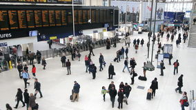 Saint Pancras Railway Station in London. Travelers and electronic notice board in the central hall of St. Pancras railway station on December 30, 2012 in London stock video footage