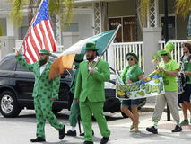Saint Patrick's Day Parade in Florida. CRYSTAL RIVER, FL – March 17: people carrying flags and wearing green march to celebrate Saint Patrick's Day in Royalty Free Stock Photo