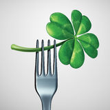 Saint Patrick Day Food. Symbol as a fork with a green four leaf shamrock clover as a traditional celtic meal symbol for Irish heritage dinner or eating in royalty free illustration