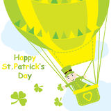 Saint Patrick Day`s card with cute ant in hot air balloon and shamrock leaves Stock Image
