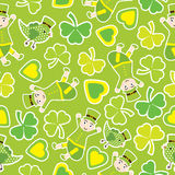 Saint Patrick Day`s seamless pattern with cute ant and shamrock leaves on green background Stock Image