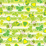 Saint Patrick Day`s seamless pattern with cute ant and shamrock leaves on stripes background Stock Image