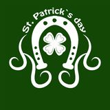 Saint Patrick day symbol of horseshoe and four-leaf clover leaf or lucky shamrock. Stock Photography