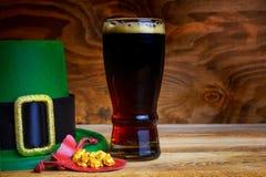 Saint Patrick day symbols green hat and leprechaun gold Stock Images