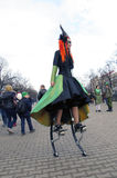 Saint Patrick festival, Moscow. Russia. Moscow. March 18, 2017. Saint Patrick festival at Sokolniki park. Woman dressed in witch costume on the mechanical stilts Royalty Free Stock Photography