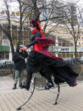 Saint Patrick Festival, Moscow. Russia. Moscow. March 18, 2017. The festival  of Saint Patrick at Sokolniki park. Woman dressed in witch costume  walking on the Royalty Free Stock Images