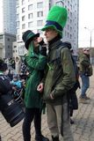 Saint Patrick Festival, Moscow. Russia. Moscow. March 18, 2017. The festival of Saint Patrick at Sokolniki park. The young woman paints the face of her friend Stock Photos