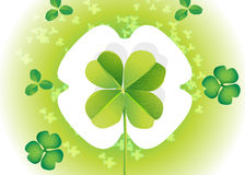 SAINT PATRICK'S CLOVER. A nice composition of 3 leaves clovers shows a big 4 leaves one in tcenter Royalty Free Stock Image