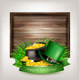 Saint Patrick`s Day background with a green hat and gold coins Royalty Free Stock Image