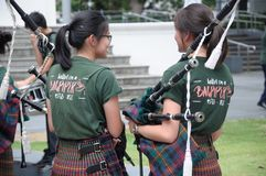 Saint Patrick`s Day bagpiper music band girls Stock Photography