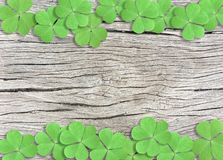 St. Patrick`s Day Background with Green Shamrocks on Wooden Texture stock photos