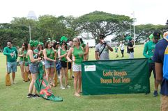 Saint Patrick`s Day Gaelic Dragon team gathering at Empress Lawn in Singapore Royalty Free Stock Image