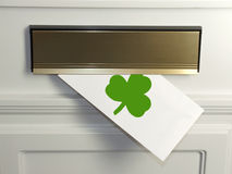 Saint Patrick's Day Greeting. A Saint Patricks Day Greeting card arrives in the mail Royalty Free Stock Image