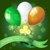 Saint Patrick's Day Greeting Card. Saint Patrick's Day festive greeting card with golden shamrock and balloons Royalty Free Stock Photo