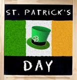 Saint Patrick s Day and Irish Flag on Blackboard Royalty Free Stock Photography