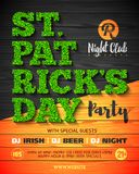 Saint Patrick`s Day party poster design. 17 March nightclub invitation with green glass lettering on wooden background Stock Photo