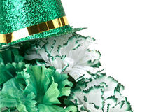 Saint Patrick's Day Still Life. Of green and white carnations and a glittered green and gold top hat Royalty Free Stock Photos