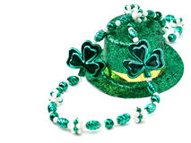 Saint Patrick's Day Still Life. Of a glittered green and gold top hat and shamrock beads Royalty Free Stock Photography
