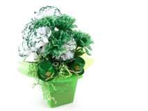 Saint Patrick's Day Still Life. Of green and white carnations with two glittering top hats on white with copy space Royalty Free Stock Images