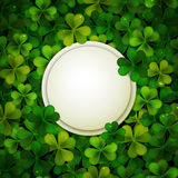 Saint Patrick's Day vector background, round banner with shamrock leaves Royalty Free Stock Images