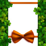 Saint Patrick's Day vector background with shamrock leaves, orange bow and banner Stock Images